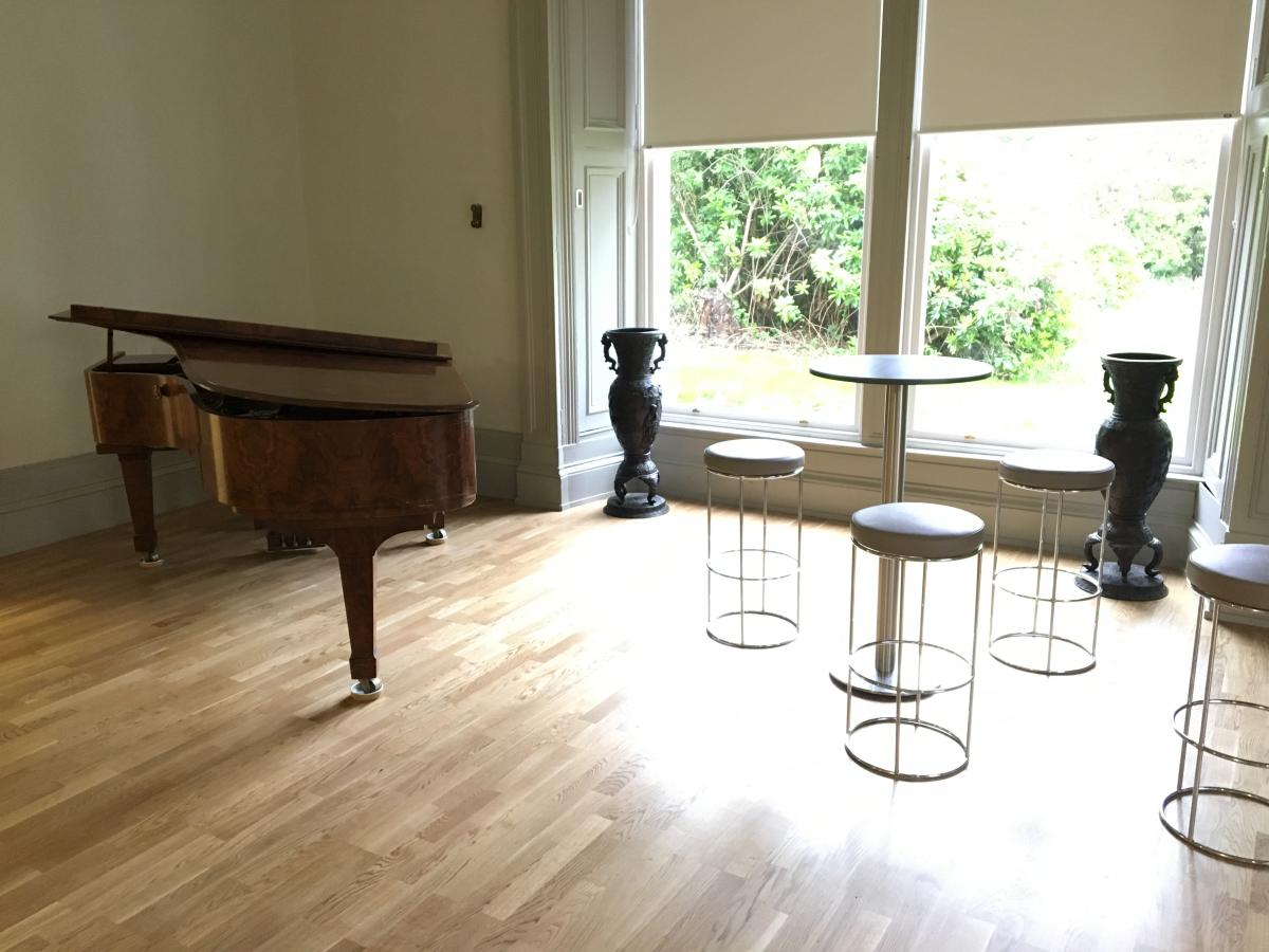 Image of room with piano