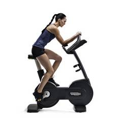 Woman on gym bike
